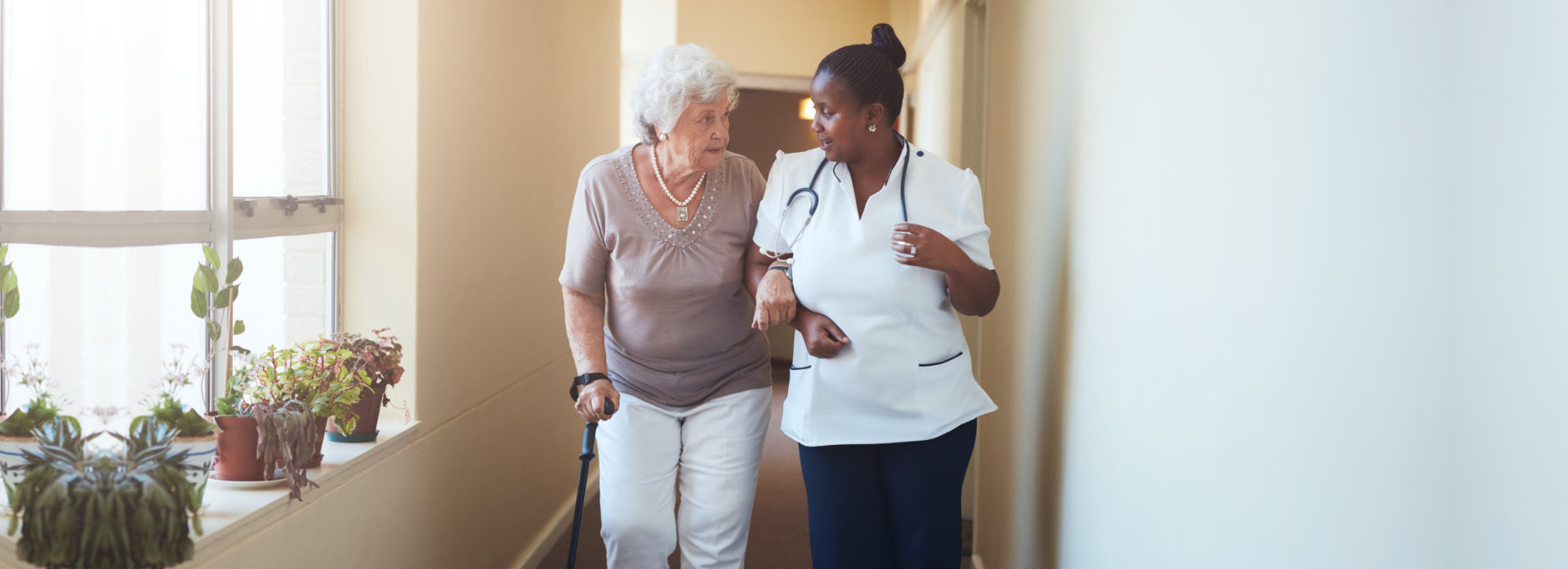 nurse and old woman talking